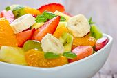 stock photo of fruit bowl  - Mixed Fruit salad in the bowl close up - JPG
