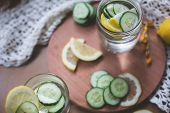 stock photo of cucumber  - infused fresh and tasty lemon cucumber water - JPG