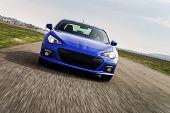 picture of speeding car  - Powerful car on race way - JPG