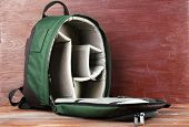 picture of knapsack  - Backpack for camera on wooden background - JPG