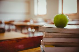 picture of piles  - Apple on pile of books at the elementary school - JPG