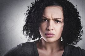 stock photo of pissed off  - Closeup portrait of a frowning woman - JPG