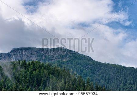 Rocky mountain outcrop beneath cloudy