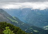 pic of bavarian alps  - Picturesque Overview of Lush Mountain Valley Under Overcast Sky - JPG