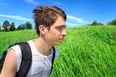 pic of knapsack  - Teenager with Knapsack walk in the Summer Field - JPG
