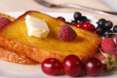 image of french-toast  - French toast with honey and fresh berries macro on a plate - JPG