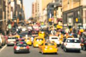 image of cabs  - Rush hour with defocused cars and yellow taxi cabs  - JPG