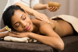 image of scrubs  - Spa therapist applying scrub salt on young woman back at salon  spa - JPG