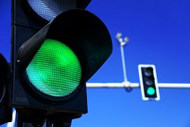 picture of traffic signal  - Traffic lights over blue sky - JPG