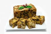 Traditional Christmas fruitcake with holly decoration,