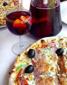 Pizza and sangria served in an italian restaurant