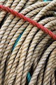 Background of dirty old fishing ropes under sunlight