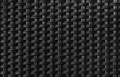 Black textured surface of interlaced nylon strings