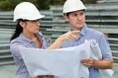 Young Engineer Woman Shows Her Co-worker Around The Site