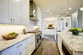 Постер, плакат: White Kitchen Design In New Luxurious Home