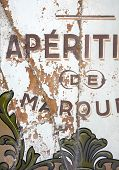 Old abandoned traditional French restaurant shop front sign