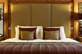 Bed with large headboard in a luxury hotel