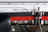 stock photo of short-story  - Once upon a time typed on an old antique typewriter - JPG