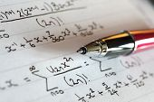 Complex mathematical trigonometry formulae on paper with pen
