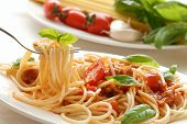 stock photo of pasta  - Fork with pasta and basil - JPG