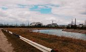 Постер, плакат: Chernobyl Alienation Zone View Of Chernobyl Atomic Plant Background River