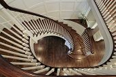 pic of entryway  - Spiral staircase in luxury home with wood railing - JPG