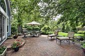 foto of lawn chair  - Brick patio with table umbrella and chairs - JPG