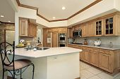 Kitchen in suburban home with oak wood cabinetry
