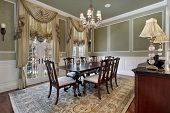 pic of light fixture  - Dining room in luxury home with french doors - JPG