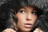 Beautiful woman. Winter fashion & makeup
