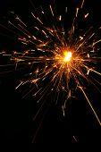 Firecracker exploding with sparks flying