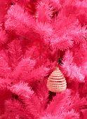 Vintage christmas decoration on a pink christmas tree
