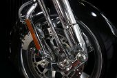 Close up of a chrome rim and wheel on a big motor bike