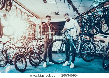 Consultant Shows Bicycle To Client