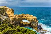 Great Ocean Road of Australia. Coastal rocks formed a picturesque arch of sandstone. Pacific ocean w poster