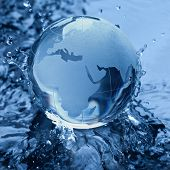 Blue Glass globe on Water wave