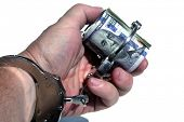 Human Hand Holds Money with Handcuffs. American Money Locked up with Hand Cuffs. Isolated on white.  poster