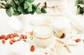 Natural Cosmetic Skincare Ingredients. Jar Of Rice Water Skin Cleansing Remedy, Almond Nuts & Eucaly poster