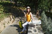 Concerned Traveler Tourist Woman In Yellow Clothes Hat With Suitcase City Map Holding Retro Vintage  poster