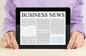 Businessman Showing Tablet PC With Business News