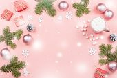 Christmas Background With Fir Branches, Lights, Red Giftboxes, Pink Decorations, Hot Drink With Snow poster