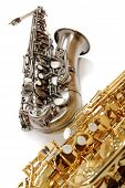 pic of saxy  - Silver saxophone and golden in the manner of background - JPG