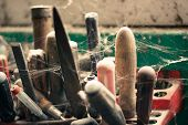 Abandoned Tool Rack Near The Barn Window. Tools Covered In Cobwebs. Toned poster