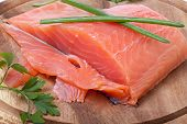 image of redfish  - salmon pieces on a chopping board - JPG
