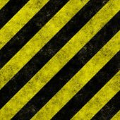 Yellow and black diagonal hazard stripes seamless texture