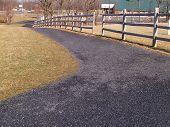 stock photo of split rail fence  - A walking path by a split wood rail fence - JPG