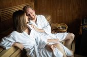 Young Happy Couple Relaxing At Spa Resort Hotel Luxury. Relax, Love, Lifestyle Concept poster