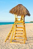 A lifesaver observation chair on a beautiful tropical beach near sunset