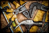 picture of workbench  - Dirty set of hand tools on a wooden panel - JPG