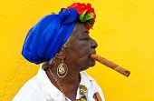 HAVANA-JUNE 29:Old black lady with a fine cigar June 29, 2011 in Havana. The african culture and rel